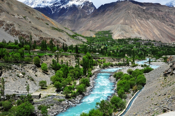 The turquoise blue river Gilgit flowing through the Chitral Valley in Khyber-Pakhtoonkhwa Pakistan  by Asim Nisar Bajwa