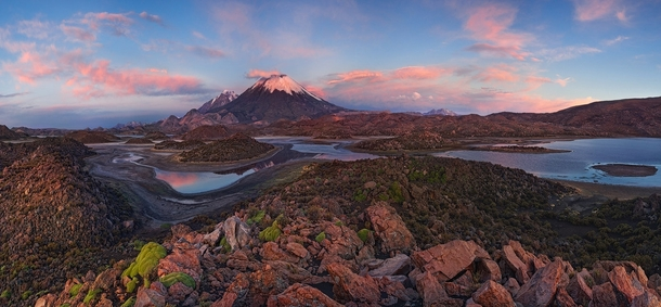 The twin peaks of the Parinacota and Pomerape volcanoes in Lauca Chile  by Mike Reyfman