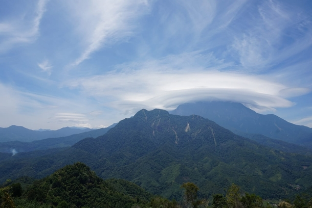 This beautiful lenticular cloud casting over Mount Kinabalu Malaysia