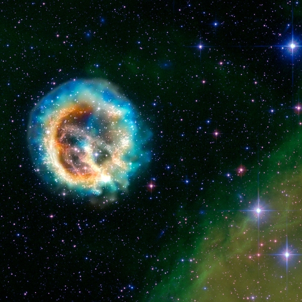 This image of the debris of an exploded star - known as supernova remnant E - or E for short - features data from NASAs Chandra X-ray Observatory E is located about  light years away in the Small Magellanic Cloudone of the nearest galaxies to the Milky Wa