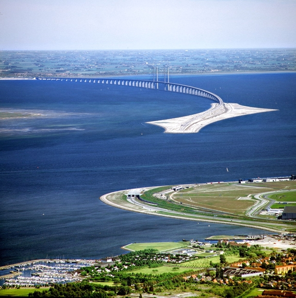 This is the bridge connecting Denmark and Sweden They made a tunnel not so ships could pass but so it doesnt interfere with the air traffic of Copenhagen Airport