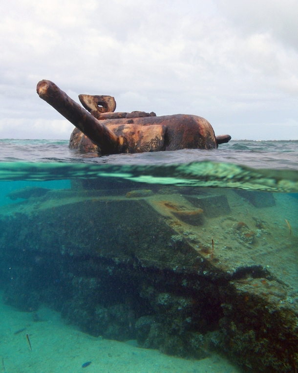 This Sherman M Tank was stranded on the reef during the invasion of the island of Saipan during WWII Its turret is still frozen in time taking aim at a Japanese gun emplacement on the beach