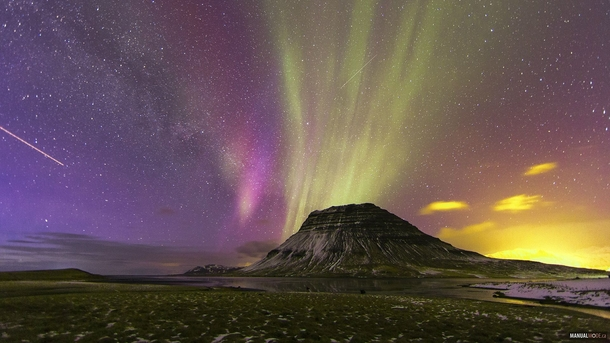 This shot has everything Mountains land water stars auroras satellites light pollution and the milky way galaxy Taken in Iceland