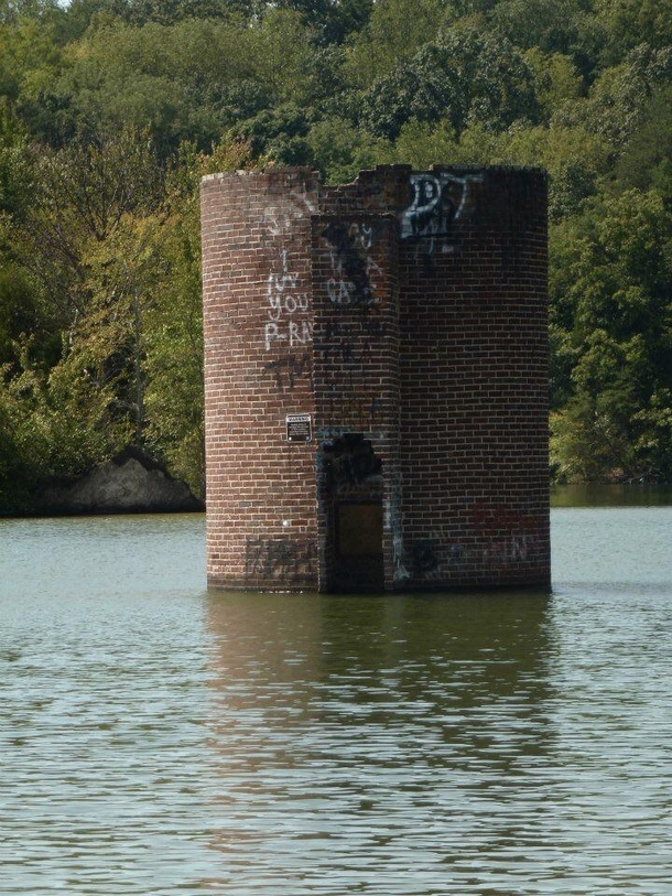 This waterlogged silo is one of many that can found on the Tellico Lake They are the remants of farms flooded by the TVA in  following the construction of the controversial Tellico Dam Vonore TN area