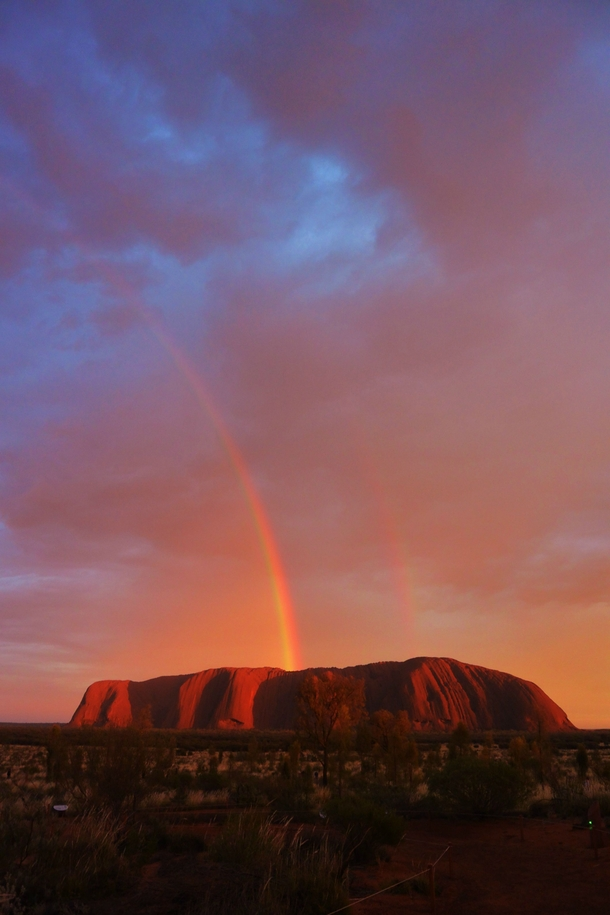 Uluru Ayers Rock treated us to a pretty spectacular full double rainbow at dawn As rare as it was beautiful