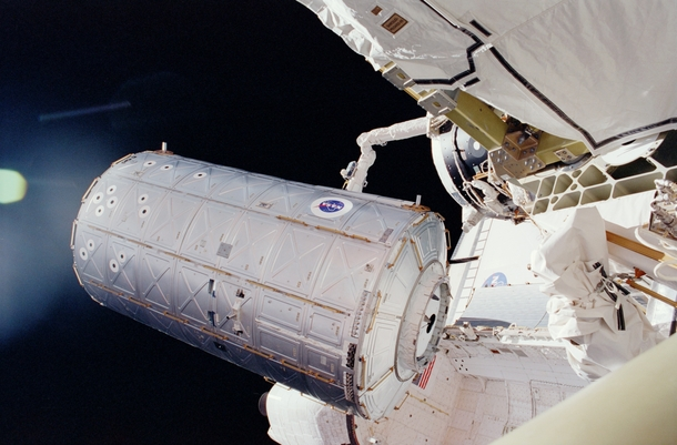 US Destiny Laboratory being moved from Space Shuttle Atlantiss cargo bay to be docked to the International Space Station in   x-post rtechnologyporn