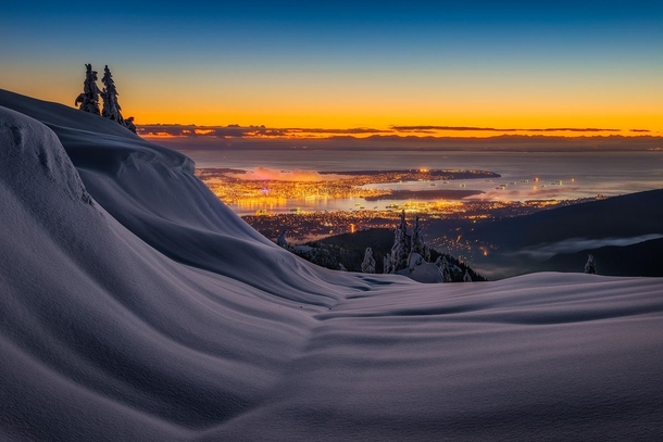 View of Vancouver from the mountains overlooking the city  by Artur Stanisz