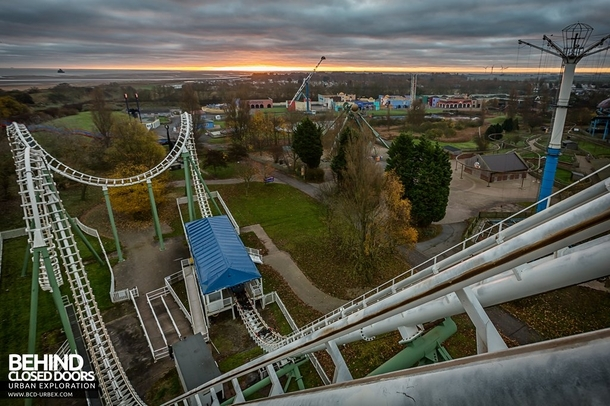 View over an abandoned theme park from the top of the roller coaster link to more pics in comments