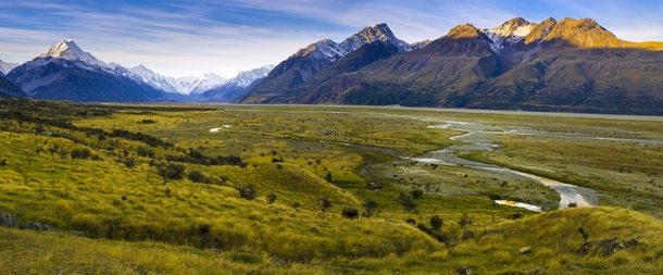 Waning evening light touches the mountain tops ringing the valley above Lake Pukaki New Zealand Aoraki Mount Cook can be seen at the far left standing sentinel over the broad valley and surrounding mountains  by Brandon Verdoorn