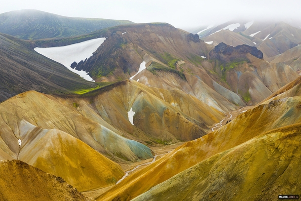 We walked across this spectacular valley of colorful mountains with a neat river down the gorge Never knew this place could be so geologically varied and beautiful Iceland