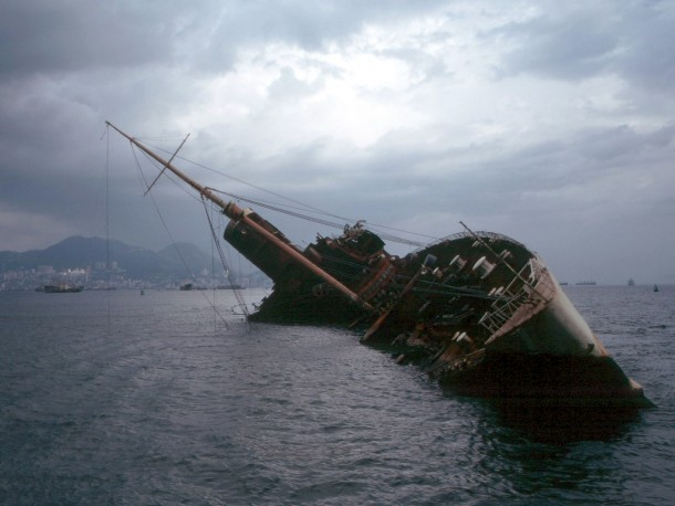 Wreck of the former RMS Queen Elizabeth then the worlds largest capsized in Victoria Harbor after ravaged by fire in  where it remained in various stages of deconstruction until it was finally buried as part of a land reclamation project in the Bay of Hon
