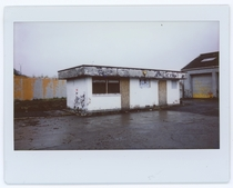 Abandonded building potentially a car wash In Stirling Scotland on polaroid Building has since been converted into a fish shop  x