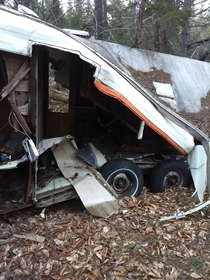 Abandoned camper in the woods behind my house East Coast Canada The mirror is perfectly intact