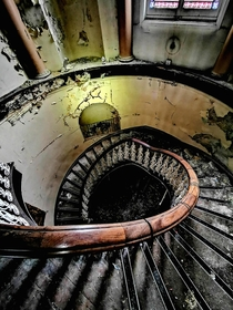 Creepy spiral staircase inside an abandoned school in Leeds England