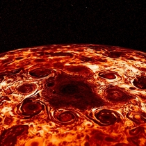 cyclonic features that surround a cyclone about  kilometers in diameter just offset from Jupiters geographic North Pole