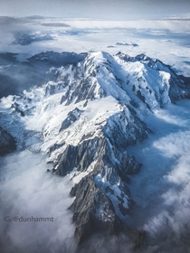 Degrees East  Degrees North - An aerial view of the Mont Blanc massif jutting above the clouds