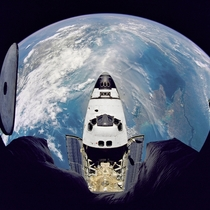 Fish-eye view of the Space Shuttle Atlantis as seen from the Russian Mir space station  photo NASA