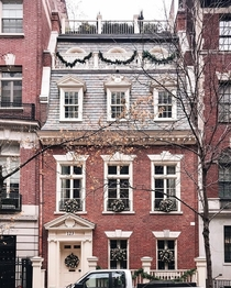 Georgian Revival townhouse with a mansard roof in Upper East Side Manhattan New York City