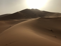 Just before sunset in the Saharan dunes Southeastern Morocco