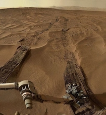 million miles away from home NASAs Mars Curiosity Rover took this shot of its leftover tracks as it drove across the planets sandy dunes