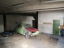 Old SAAB parked in a workshop in Sweden house now demolished