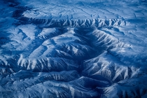Over Oregon taken flying over the mountainous terrain of Oregon in March -