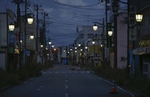 people used to live here now its a ghost town This is Namie Japan now inside the nuclear Exclusion Zone created by the Fukushima disaster The lights are left on to maintain hope of eventually returning to the town  photo by Damir Sagolj