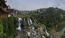 pixels Furong a Tujia peoples village in China centered about a waterfall