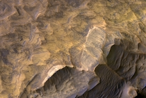 Probable sandstone deposits on West Chasma Mars taken by HiRISE