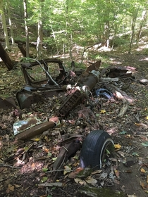 Remnants of an old car in the middle of the woods in Maryland
