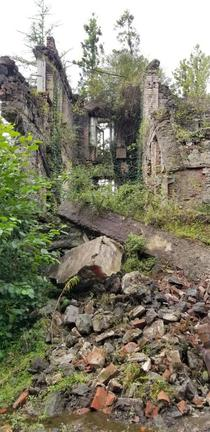 Ruined building being reclaimed by nature in Akarmara Abkhazia