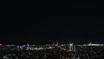 Saturn and Jupiter over the Barcelona skyline on July th with Saturns opposition