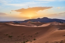 Sunrise over the dunes of the Sahara desert Moroccan side