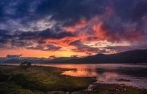 sunset over Loch Leven in the Scottish Highlands x