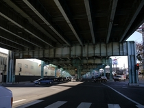 Under the steel girder portion of the Central Freeway completed to Mission Street in  before prestressed concrete became the material of choice for viaducts
