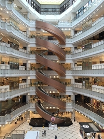 Worlds largest spiral escalator - New World Daimaru Department Store Shanghai