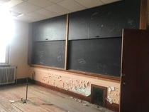 year old high school with slide down chalk boards