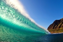 A back-lit wave on West Shore Oahu Hawaii