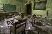 A badly decayed classroom found in the basement of an abandoned church OC X