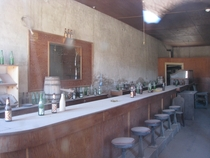 A bar in the ghost town of Bodie CA through the front window