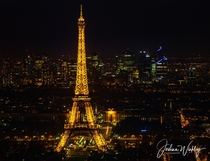 A beacon like Eiffel Tower with a backdrop of La Defence Paris France
