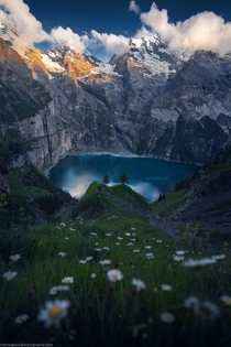 A beautiful alpine lake in the Swiss Alps  by marcograssiphotography