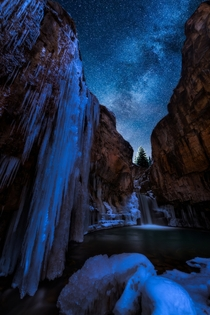 A beautiful frozen waterfall beneath a blanket of stars - Lime Creek Falls San Juan National Forest Colorado  Photo by Matt Payne