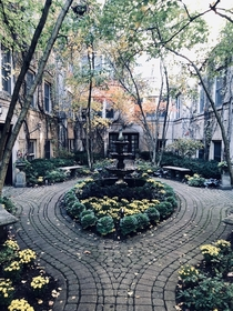 A beautiful inner courtyard of an apartment building somewhere in Oak Park IL