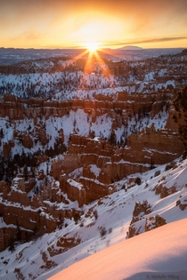 A beautiful shot from the bottom up of a snowy Bryce Canyon in Utah at sunrise  Photo by Michelle Pilling