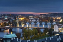 A beautiful sunset in Prague overlooking the Vltava river and the iconic Charles Bridge