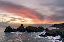 A beautiful sunset over one of UKs most beautiful beaches - Kynance Cove Cornwall
