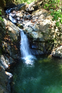 A beautiful waterfall in Costa Ricas rain forest  x