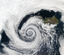 A beautifully-formed low-pressure system swirling off of the southwestern coast of Iceland looks eerily like a spiral galaxy andor a large swirling cloud of hydrogen fragmenting away from a much larger cloud of hydrogen and undergoing gravitational collap