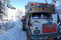 A Bhutanese bus makes it through the snow